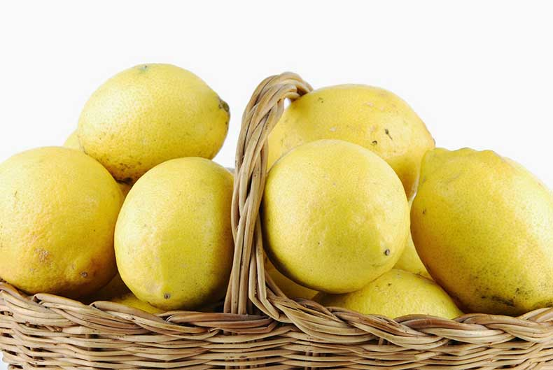 1786916-close-up-of-lemons-in-a-wicker-basket-on-white-040214-900