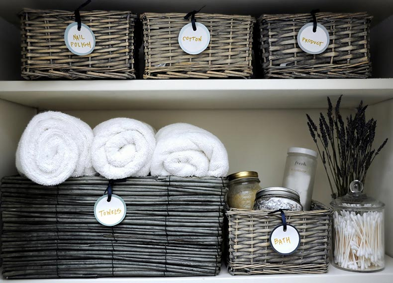 deliciously_organized__organizing__linen_closet_+_diy_round_labels_organize_linen_closet_
