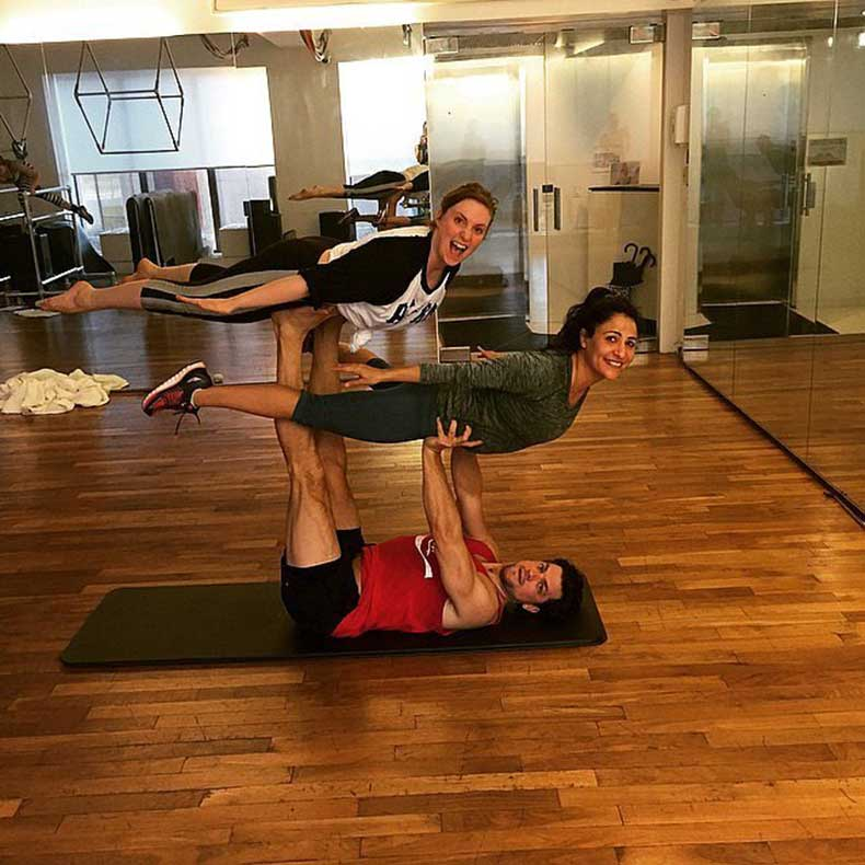 Lena-Dunham-getting-little-Acro-Yoga-action