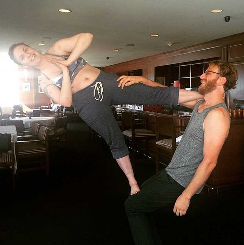 Lena-Dunham-smiling-sideways-during-AcroYoga-lesson