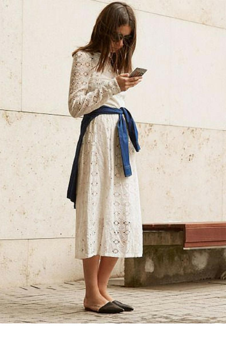 sneakers+an+dpearls,+street+style,+black+flat+mules+with+a+white+lace+dress,+trending+now