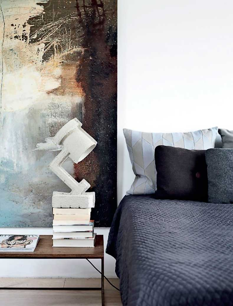 Bedroom-in-Denmark-Apartment-with-Gray-Bedspread-and-Artwork,-Remodelista