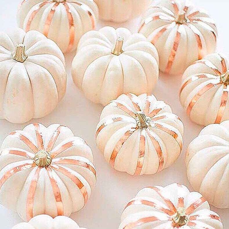 Bronze-stripes-made-paint-tape-make-white-pumpkins-pop