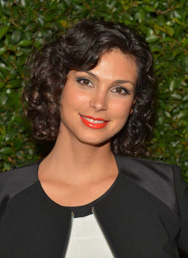 Morena-Baccarin-paired-her-curly-bob-tangerine-lip
