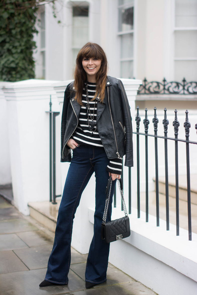 EJSTYLE-Zara-flared-jeans-Zara-black-white-striped-jumper-sweater-leather-biker-jacket-Chanel-boy-bag-black-small-Givenchy-shark-tooth-necklace-OOTD-Winter-outfit-Emma-Hill