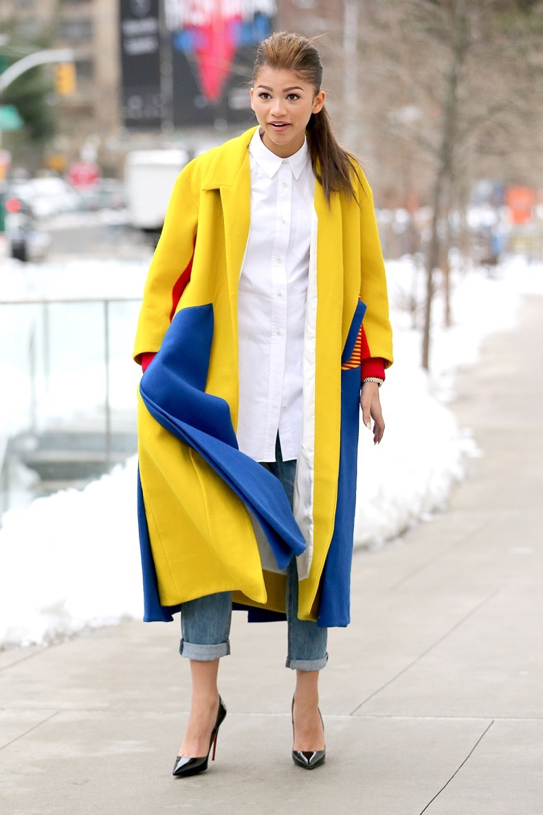 New York, NY - Actress/singer Zendaya poses for pictures like a model in the streets of New York. Zendaya showed off her chic winter style dressed in a white blouse with ripped jeans, a yellow and blue color block coat and black Christian Louboutin heels. AKM-GSI February 8, 2014 To License These Photos, Please Contact : Steve Ginsburg (310) 505-8447 (323) 423-9397 steve@akmgsi.com sales@akmgsi.com or Maria Buda (917) 242-1505 mbuda@akmgsi.com ginsburgspalyinc@gmail.com