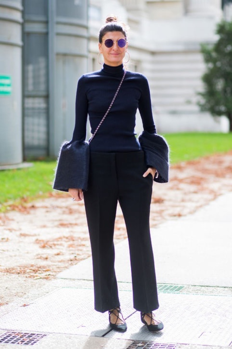 bell-sleeve-top-outfit-ideas-ribbed-top-trousers-flats-getty-images-h724