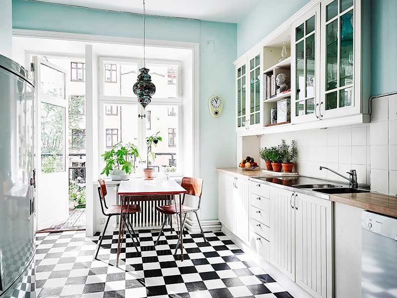 mint-kitchen-with-black-and-white-floor