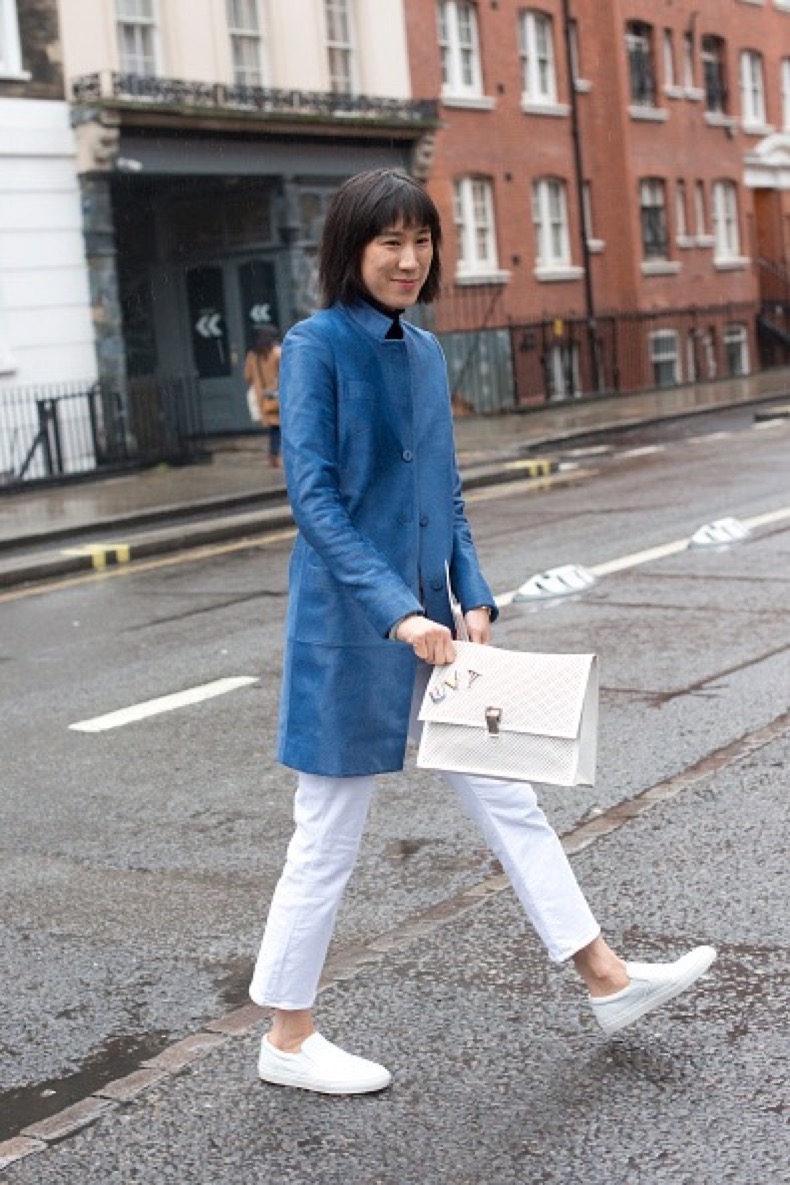 LONDON, ENGLAND - FEBRUARY 20: Head of Fashion Partnerships at Instagram Eva Chen wears a Koja coat, J Brand jeans, Greats shoes and Proenza Schouler bag on day 2 during London Fashion Week Autumn/Winter 2016/17 on February 20, 2016 in London, England. (Photo by Kirstin Sinclair/Getty Images)