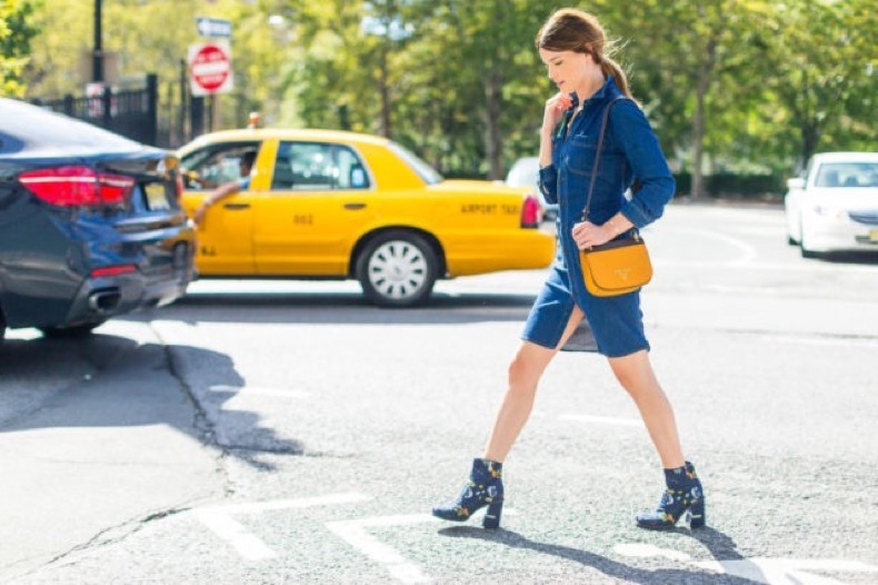denim-dress-printed-booties-fall-work-outfit-nyfw-street-style-fall-outfits-hbz-640x426