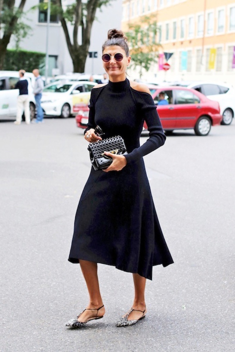 le-fashion-blog-street-style-giovanna-battaglia-top-knot-round-sunglasses-black-cold-shoulder-dress-patent-bag-printed-pointed-toe-flats-via-nytimes