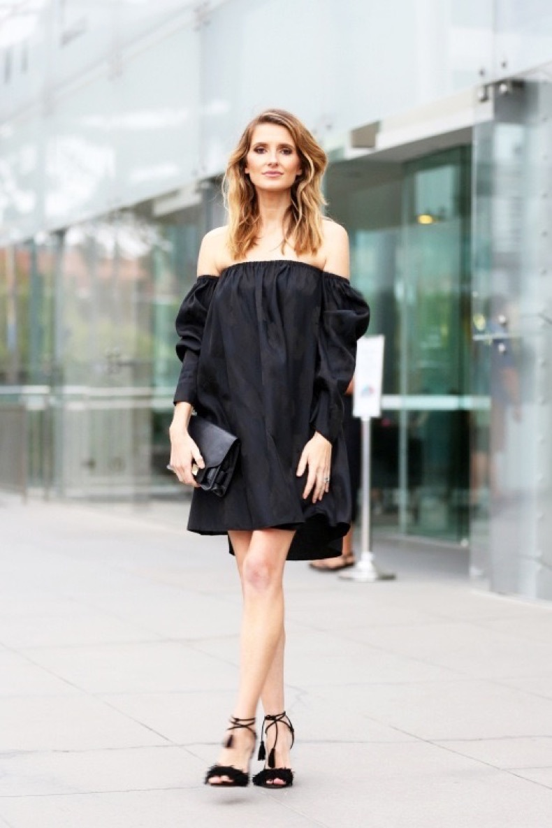 le-fashion-blog-summer-date-night-look-street-style-black-off-the-shoulder-dress-ankle-wrap-sandals-with-fringed-details-leather-clutchvia-vogue-australia